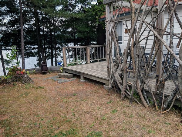 Side yard with deck and lake view